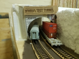 A cardboard cutout of the proposed size of the tunnel opening. Need to make sure that the all the rollingstock fits before we make the final one