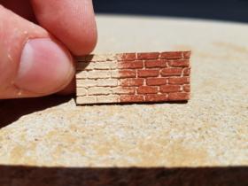 1/2 painted test piece of brickwork
